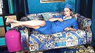 Naughty stewardess Claire Adams moans while masturbating