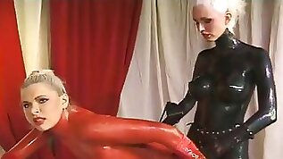 Some lusty latex queens with sexy boobies are working on wet cunts