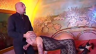 Tattooed slut gets licked and fucked by hung bald guy on bed