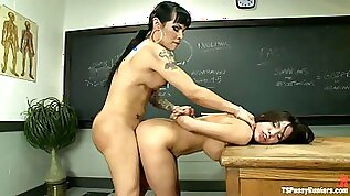 Transsexual Teacher Fucking Busty Students Pussy on Her Desk