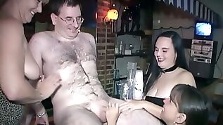 Older hairy man in glasses gets seduced by three voracious whores