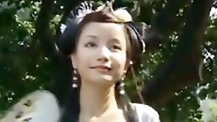 Beautiful Chinese Girl Walks Through A Garden