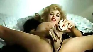 Retro pornstar banging with huge dildo