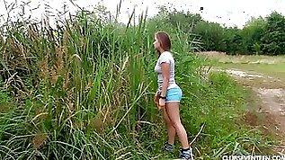 Pretty girl alone in the grass finger fucks her wet vagina