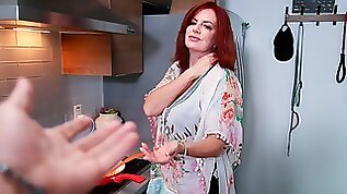 Redhead MILF Andi James opens her crack for a long penis