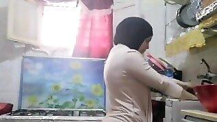Routine hijab arabic muslim in kitchen