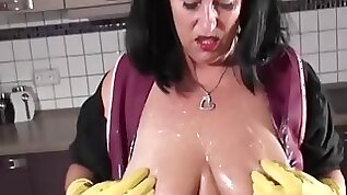 Mature milf with big monster cock in the kitchen wearing rubber gloves