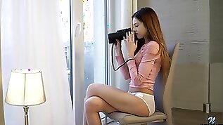 Svelte young chick Akira May gets her horny while spying on neighbors