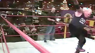 Blonde teen babe fights a guy in a wrestling match