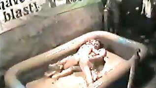 Mud wrestling girls at the bar make a sexy mess
