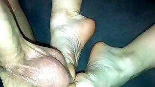 Amateur footjob intense ballbusting with cum on veiny feet