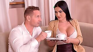 Beautiful fake boobed brunette Honey Demon rides on a big dick