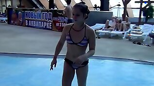 Petite Russian teen is flashing in a public swimming pool
