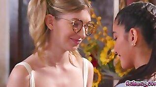 Mackenzie Moss moans as Emily Willis rubs clit betw