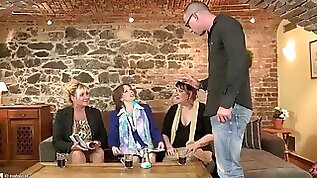 Orgy with mature mothers and one young cock
