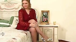 Horny slut MILF in stockings calls a young boy for some action