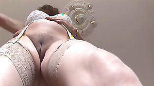 Busty mature with huge boobs and hairy pussy strips