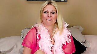 Ravishing blonde amateur MILF with huge tits rubs her wet cunt