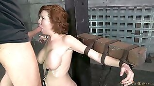 Restrained busty red head Veronica Avluv gets her throat rammed hard