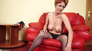 Big tits mature damsel inserting massive toy in pussy