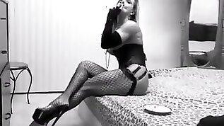 Smoking pierced slut in corsets and heels