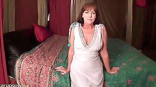 Milf Cynthia Davis strips and toys her pussy