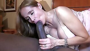 Adorable blonde amateur MILF deepthroating a big black cock
